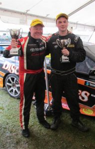 Jason Bargwanna (left), from Victoria, and Liam MacDonald show off their  silverware from the last NZ Touring Car Series racing at Teretonga. Bargwanna took out a Class 1 win for the weekend and MacDonald took out the class 2 win.